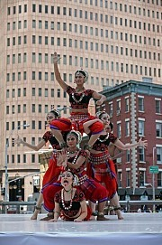 """Members of Sutra Dance Theater, of Malaysia, in """"Visions of Forever"""" on Thursday at One New York Plaza, at the lower tip of Manhattan.[Credit: Marilynn K. Yee/The New York Times]"""