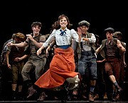 'Newsies the Musical'Ms. Lindsay, center, with members of the cast.[Credit: Sara Krulwich/The New York Times]