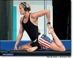 American swimmer Dara Torres stretches during the team's first practice in Sydney. Physiologists say elite swimmers have bodies that are particularly suited to their sport - but there's more to winning a medal than biomechanics.
