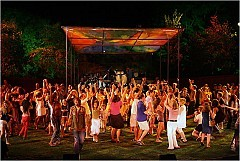 """[Sara Krulwich/The New York Times]At the conclusion of the Public Theater's production of """"Hair"""" at the Delacorte Theater, the audience is invited onstage to dance with the cast members."""
