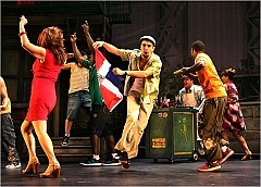 """[Sara Krulwich/The New York Times]The cast of """"In the Heights,"""" with the songwriter Lin-Manuel Miranda, center."""