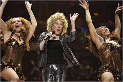 [Laura Rauch for The New York Times] Bette Midler, center, with two Harlettes, going on in her new show at the Colosseum at Caesars Palace in Las Vegas.
