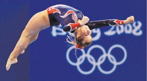 [T H O M A S K I E N Z L E /A P] TOP OF THEIR GAMES Top, U.S. gymnast Shawn Johnson during her gold medal-winning performance on the balance beam yesterday.