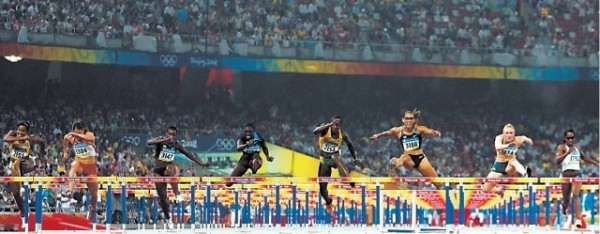 [N I C K L A H A MG E T T Y]DRAMATIC FINISH American Dawn Harper, fourth from left, wins the gold medal in the 100-meter hurdles. Her teammate and race favorite, Lolo Jones, third from right, hit her foot on the ninth hurdle and came in seventh.