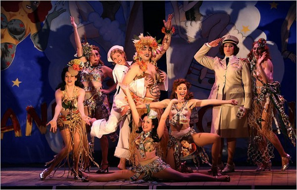 """[Sara Krulwich/The New York Times]<br>Danny Burstein as Luther Billis, center, with Kelli O'Hara and the cast of """"South Pacific."""""""