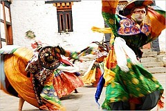 """Dancers at the Yungdrung Choeling Palace in Bhutan's Trongsa District in May 2007./ Meanwhile Joseph Houseal, a choreographer and dance preservationist, investigated Bhutanese cham dances, and noninvasive ways to record them. """"People came to trust us, and they let us see secret things,"""" he said. """"We revived four dances and saved one from extinction that was only known to one person in his 80s.""""[Photo: Heloisa Oliveira]"""
