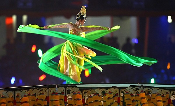 [Jeff Gross/Getty Images)]<br>A dancer performs during the Opening Ceremony for the 2008 Beijing Summer Olympics at the National Stadium on August 8, 2008 in Beijing, China.