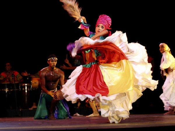 [Photograph: Congas Productions]The company is known for its bright and elaborate costumes