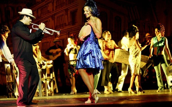 [Photograph: Congas Productions] Amarylis Pons (in the blue dress) is one of Havana Rakatan's lead dancers