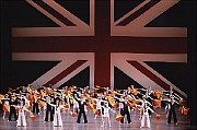"Balanchine's ""Union Jack,"" the closing act of New York City Ballet's fund-raising ""Dancers' Choice"" evening on Sunday. The dancers' semaphore flag signals spell out ""God Save the Queen."" [Paul Kolnik/New York City Ballet]"